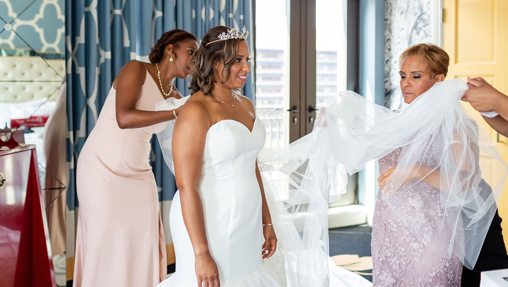Bride getting ready with the help of other women