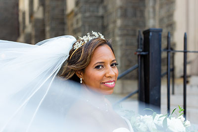 Bride smiling with large veil